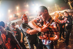 Hand grips with the students. IKMS 'In The Club' seminar with KMG Global Team Instructor and Expert Level 5, Tommy Blom, at the Buff Club in Glasgow's City Centre. Bringing Krav Maga training out with the confines of the gym into a real nightclub/bar.<br /> &copy; Michael Schofield.