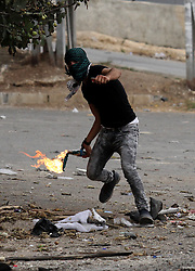 """23.10.2015, Nablus, PSE, Gewalt zwischen Palästinensern und Israelis, im Bild Zusammenstösse zwischen Palästinensischen Demonstranten und Israelischen Sicherheitskräfte // A Palestinian youth throws a moltov cocktail during clashes with Israeli security forces at the Hawara checkpoint, south of the West Bank city of Nablus on October 22, 2015. Palestinian factions called for mass rallies against Israel in the occupied West Bank and East Jerusalem in a """"day of rage"""" on Friday, as world and regional powers pressed on with talks to try to end more than three weeks of bloodshed, Palestine on 2015/10/23. EXPA Pictures © 2015, PhotoCredit: EXPA/ APAimages/ Nedal Eshtayah<br /> <br /> *****ATTENTION - for AUT, GER, SUI, ITA, POL, CRO, SRB only*****"""