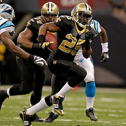 Nov 08, 2009; New Orleans, LA, USA;  New Orleans Saints running back Reggie Bush (25) runs away from Carolina Panthers cornerback Richard Marshall (31) during the fourth quarter at the Louisiana Superdome. The Saints defeated the Panthers 30-20. Mandatory Credit: Derick E. Hingle