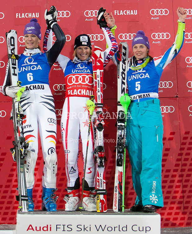 20.12.2011, Hermann Maier Piste, Flachau, AUT, FIS Weltcup Ski Alpin, Damen, Slalom Podium, im Bild Maria Hoefl-Riesch (GER, Rang 2), Marlies Schild (AUT, Rang 1) und  Tina Maze (SLO, Rang 3) // second place Maria Hoefl-Riesch of Germany, first place Marlies Schild of Austria, dirt place Tina Maze of Slovenia, on Podium Slalom at FIS Ski Alpine Worldcup at Hermann Maier Pist in Flachau, Austria on 2011/12/20. EXPA Pictures © 2011, PhotoCredit: EXPA/ Johann Groder
