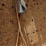 A bow, cane and hat hanging on the outer wall of a homestead in the village of Berwong in the Upper West Region of Ghana.