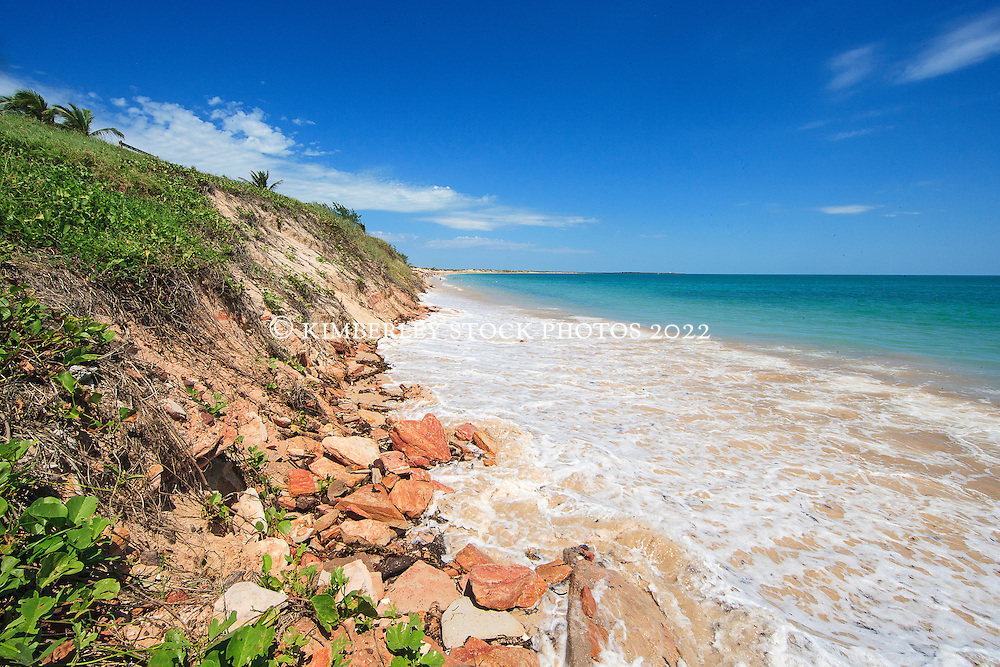 Waves reach right to the base of the dunes on a super high tide at Broome's Cable Beach.