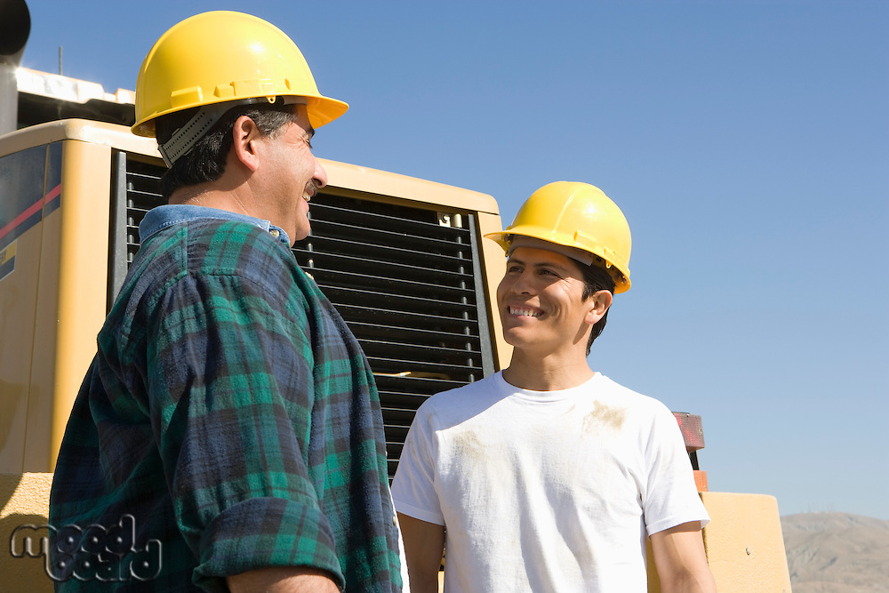 Construction Workers talking and smiling