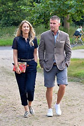 ALICE BRUDENELL-BRUCE and NICK LOVE attending Annabel Goldsmith's Summer party held at her home in Ham, Surrey on 10th July 2014.