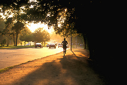 Stock photo of a man jogging along Memorial Drive in Memorial Park.