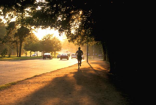 Stock photo of a man jogging along Memorial Drive in Memorial Park.