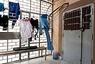 Libya, Misurata: clothes of women and children rescued from the fighting area in Sirte and held inside the Libyan airforce compound in Misurata hanging outside their cells. Alessio Romenzi