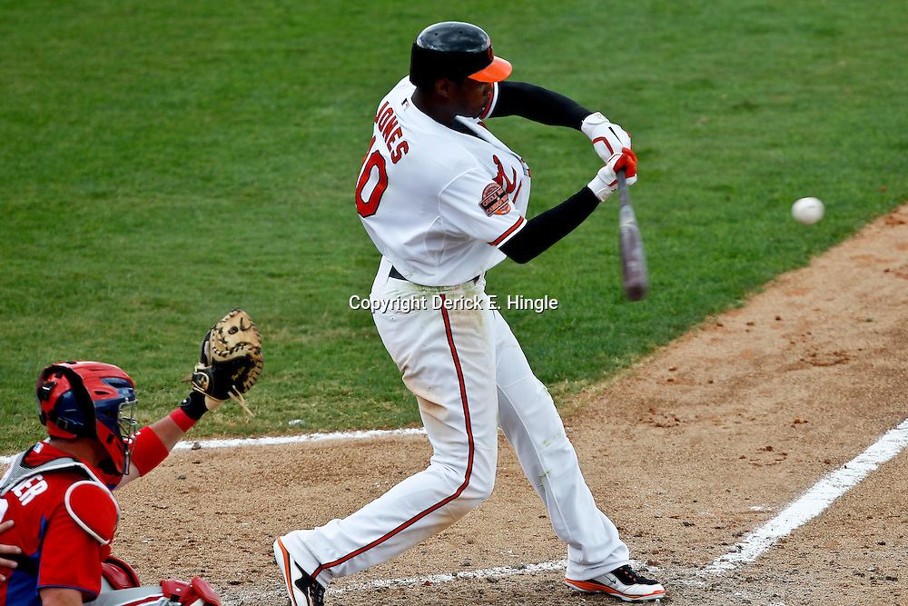 March 20, 2012; Sarasota, FL, USA; Baltimore Orioles center fielder Adam Jones (10) grounds out against the Philadelphia Phillies during the bottom of the seventh inning of a spring training game at Ed Smith Stadium.  Mandatory Credit: Derick E. Hingle-US PRESSWIRE