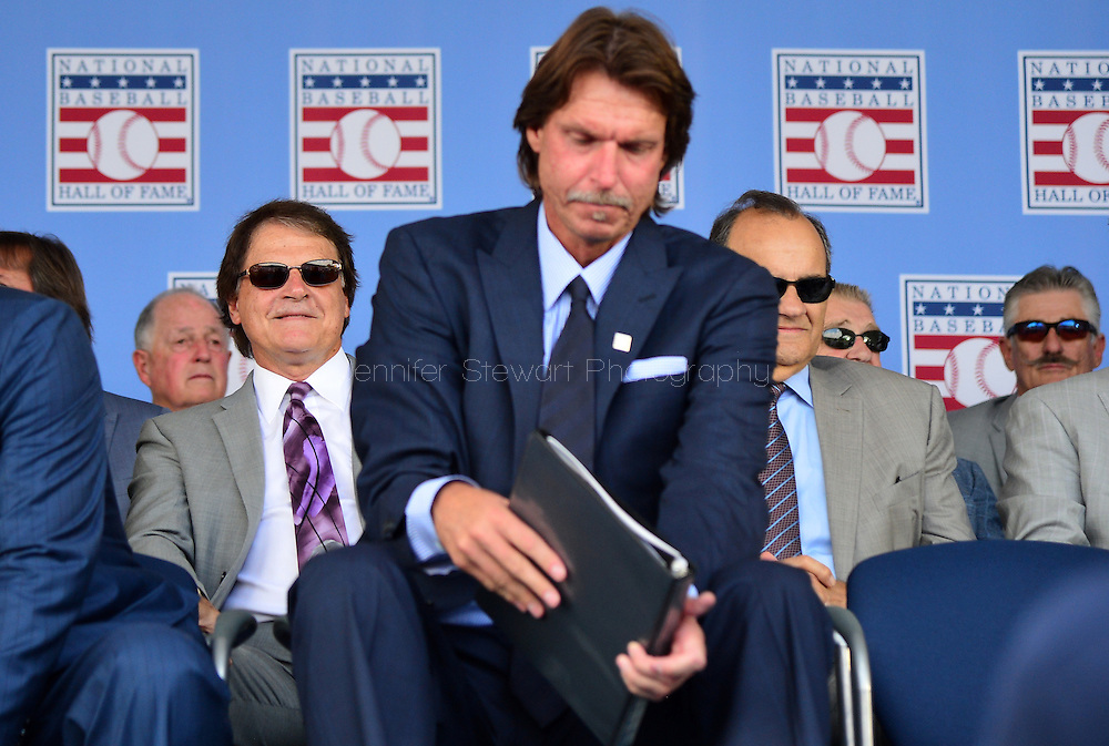 COOPERSTOWN, NY - JULY 26: Hall of Famer Tony La Russa smiles while sitting behind inductee Randy Johnson during the Induction Ceremony at National Baseball of Hall of Fame on July 26, 2015 in Cooperstown, New York. (Photo by Jennifer Stewart/Arizona Diamondbacks/Getty Images)