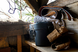 German Luftwaffe/Fallschirmjäger Mess tins gloves and belt sit on a shelf in camouflaged bunker at the Yorkshire War weekend<br />