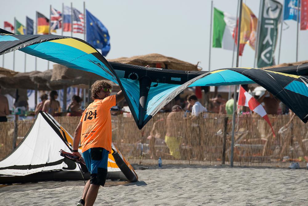 Jordan Girdis(AUS), 20, takes his sail back after the race at European Kiteracing Championship, Hangloose Beach, Calabria (IT)