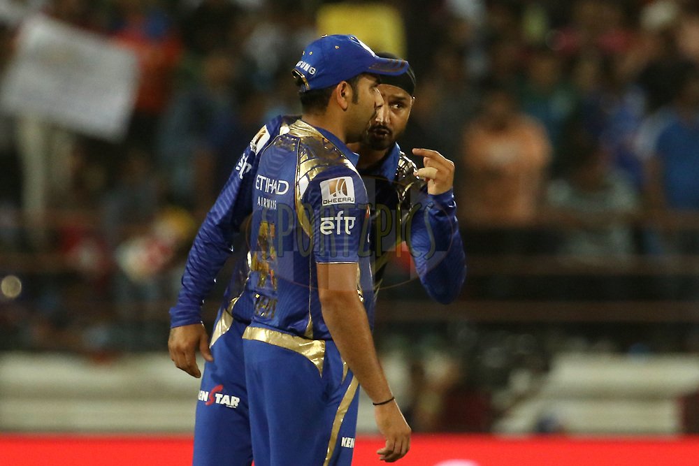 Harbhajan Singh of the Mumbai Indians speaks with Mumbai Indians captain Rohit Sharma during match 35 of the Vivo 2017 Indian Premier League between the Gujarat Lions and the Mumbai Indians  held at the Saurashtra Cricket Association Stadium in Rajkot, India on the 29th April 2017<br /> <br /> Photo by Vipin Pawar - Sportzpics - IPL
