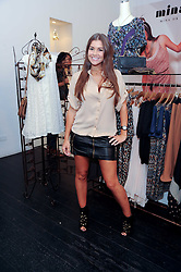 IMOGEN THOMAS at a party to celebrate the opening of the new Mina Store at 36-38 Great Titchfield Street, London W1W 8BQ on 9th September 2010.  The party was sponsored by Ivan the Terrible Vodka.