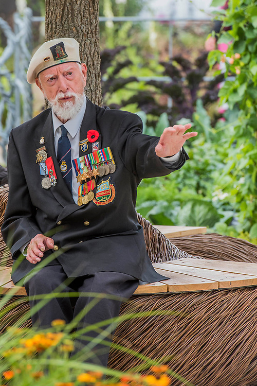 Lewis trinder, 92, Royal Navy and arctic convoy veteran on Blind Veterans UK: its all about Community Garden by Andrew Fisher Tomlin and Dan Bowyer - The Hampton Court Flower Show, organised by the Royal Horticultural Society (RHS). In the grounds of the Hampton Court Palace, London.