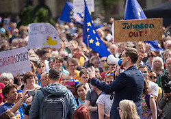 """© Licensed to London News Pictures. 31/08/2019. Bristol, UK. DARREN JONES MP for Bristol North West speaks to several thousand protesters who had taken part in the Stop the Coup march through Bristol city centre against the proroguing of Parliament. Many also chanted that """"no one voted for Boris"""". There were some EU flags in the city that voted in the referendum by a large majority against Brexit to remain in the EU. Photo credit: Simon Chapman/LNP."""