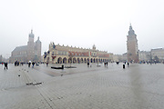 Market Square, St. Mary's Cathedral and Cloth Hall in mist, Krakow, Poland