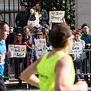 "NYTRUN - NOV. 6, 2016 - NEW YORK - Spectators holding signs including one which reads ""If Trump Can Run So Can You"" cheer on runners in the 2016 TCS New York City Marathon as they run down 5th Ave. near E 91st Street on Sunday afternoon. NYTCREDIT:  Karsten Moran for The New York Times"