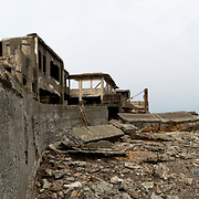 "NAGASAKI, JAPAN - AUGUST 8: Panoramic view inside of Hashima Island, commonly known as Gunkanjima or ""Battleship Island"" in Nagasaki Prefecture, southern Japan on August 8, 2017. The island was a coal mining facility until its closure in 1974 is a symbol of the rapid industrialization of Japan, a reminder of its dark history as a site of forced labor during the Second World War. The island now is recognized as UNESCO's World Heritage sites of Japan's Meiji Industrial Revolution. (Photo: Richard Atrero de Guzman/NURPhoto)"