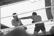 Ali vs Lewis Fight, Croke Park,Dublin.<br /> 1972.<br /> 19.07.1972.<br /> 07.19.1972.<br /> 19th July 1972.<br /> As part of his built up for a World Championship attempt against the current champion, 'Smokin' Joe Frazier,Muhammad Ali fought Al 'Blue' Lewis at Croke Park,Dublin,Ireland. Muhammad Ali won the fight with a TKO when the fight was stopped in the eleventh round.<br /> <br /> Picture of Lewis as he lands a left into the Ali chest.