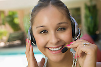 Woman Using Telephone Headset