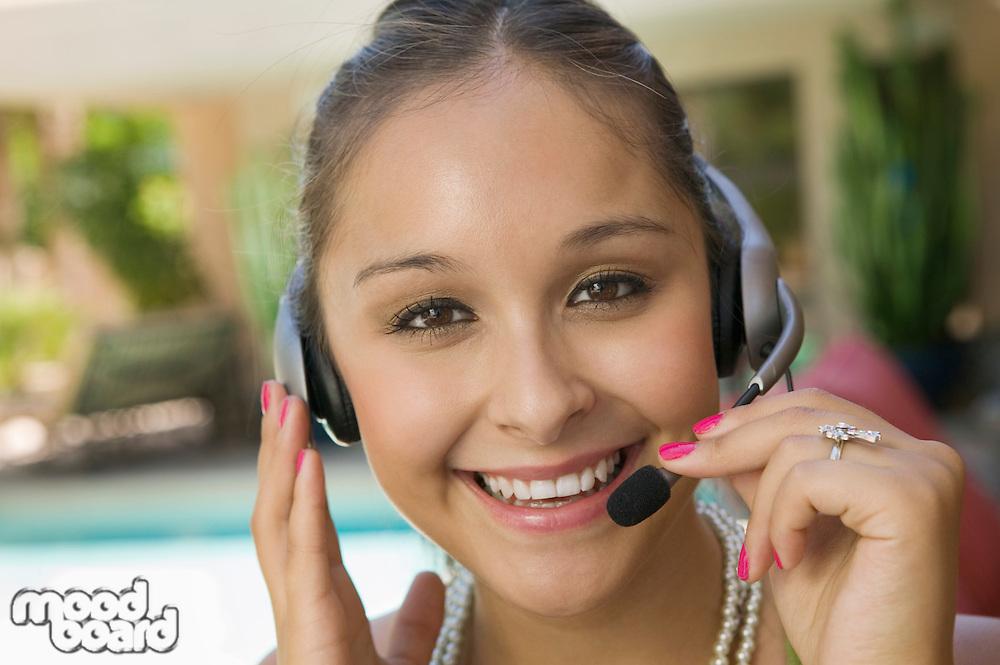 Woman Using Telephone Headset