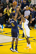 Golden State Warriors guard Nick Young (6) tries to block a shot by Utah Jazz guard Joe Johnson (6) at Oracle Arena in Oakland, Calif., on December 27, 2017. (Stan Olszewski/Special to S.F. Examiner)