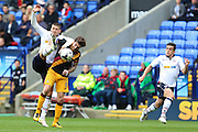 Bolton Wanderers striker Jamie Proctor (9) tries to get onto the end of a long ball to play Bolton Wanderers striker Zack Clough (10) through whilst under pressure fro Bradford City midfielder Romain Vincelot (6)  during the EFL Sky Bet League 1 match between Bolton Wanderers and Bradford City at the Macron Stadium, Bolton, England on 24 September 2016. Photo by Simon Brady.