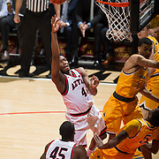 31 January 2017:  The San Diego State Aztecs men's basketball team hosts Wyoming Tuesday night at Viejas Arena. San Diego State guard Dakarai Allen (4) attempts a jump shot while being defended by Wyoming forward Alan Herndon (5) in the first half. The Aztecs lead the Cowboys 31-27 at half time. www.sdsuaztecphotos.com