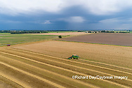 63801-14316 Aerial view of combine harvesting wheat ahead of a thunderstorm Marion Co. IL
