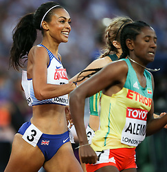 London, August 10 2017 . Adelle Tracey, Great Britain, smiles as she races with Habitam Alemu, Ethiopia, in the women's 800m heats on day seven of the IAAF London 2017 world Championships at the London Stadium. © Paul Davey.