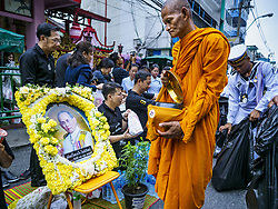October 13, 2017 - Bangkok, Thailand - A Buddhist monk walks past a portrait of Bhumibol Adulyadej, the Late King of Thailand, during a mass merit making with 199 monks from 14 different temples at Siriraj Hospital in Bangkok on the one year anniversary of the King's death. The revered King died on October 13, 2016 after a prolonged hospitalization. He has lain in state for the last year. The King's four day funeral ceremony will be October 25 - 29, and he will be cremated on October 26. (Credit Image: © Sean Edison via ZUMA Wire)