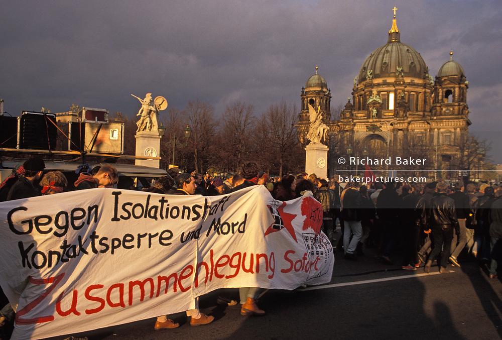 A year after the fall of the Berlin Wall and the end of the Communist Eastern Bloc era, German youths against Isolationism gather outside Berlin Cathedral, on 4th November 1990, in Berlin, Germany.