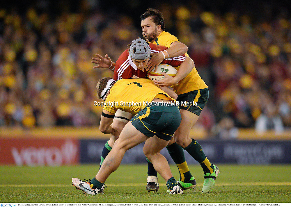 29 June 2013; Jonathan Davies, British & Irish Lions, is tackled by Adam Ashley-Cooper and Michael Hooper, 7, Australia. British & Irish Lions Tour 2013, 2nd Test, Australia v British & Irish Lions. Ethiad Stadium, Docklands, Melbourne, Australia. Picture credit: Stephen McCarthy / SPORTSFILE