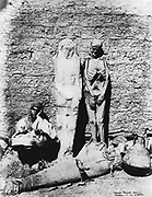 Ancient Egyptian mummies, 1860. Mummies displayed outside a tomb at Thebes. Bibliotheque Nationale, Paris. Photograph