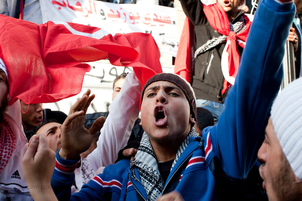 Tunis, Tunisia. January 26th 2011.Protesters outside the prime minister's office (Mohammed Ghannouchi), located on the Kasbah square. They demand the removal of members of the ousted president's regime (Zine El Abidine Ben Ali) still in the government.....