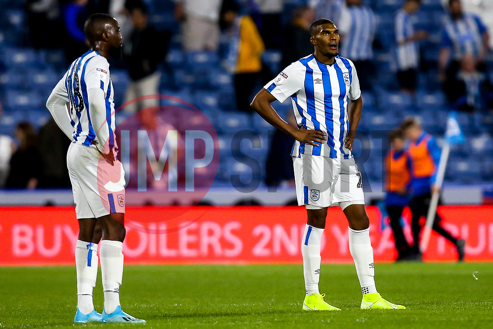 Collin Quaner of Huddersfield Town and Isaac Mbenza of Huddersfield Town cut dejected figures - Mandatory by-line: Robbie Stephenson/JMP - 05/08/2019 - FOOTBALL - The John Smith's Stadium - Huddersfield, England - Huddersfield Town v Derby County - Sky Bet Championship