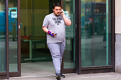 "Vojislav Ignjatovic, 26, leaves Westminster Magistrates Court in London where he was appearing on charges of hurling racist abuse at police staff after ""going off his nut"" at Kings Cross station after consuming cannabis, cocaine and whiskey. London, April 23 2019."