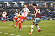 The ball hits Charlton Athletic Defender, Patrick Bauer to go out for a corner during the Sky Bet Championship match between Burnley and Charlton Athletic at Turf Moor, Burnley, England on 19 December 2015. Photo by Mark Pollitt.