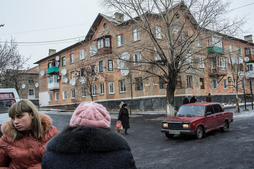 NYZHNIA KRYNKA, UKRAINE - JANUARY 27, 2015: A street scene in Nyzhnia Krynka, Ukraine. After intense fighting in the area over the summer, residents of the village are still facing severe difficulties accessing affordable food. CREDIT: Brendan Hoffman for The New York Times