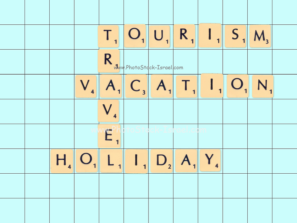 Digitally created Scrabble tiles on a board spelling out Travel tourism and holiday concepts