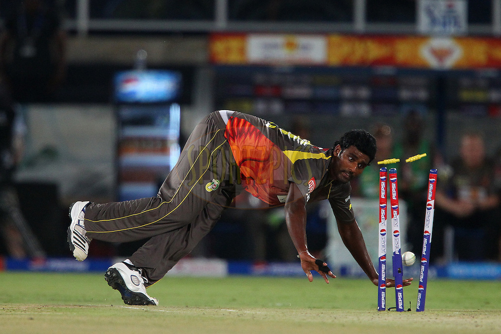 Thisara Perera breaks the stumps during match 25 of the Pepsi Indian Premier League between The Sunrisers Hyderabad and The Kings XI Punjab held at the Rajiv Gandhi International  Stadium, Hyderabad  on the 19th April 2013..Photo by Ron Gaunt-IPL-SPORTZPICS..Use of this image is subject to the terms and conditions as outlined by the BCCI. These terms can be found by following this link:..http://www.sportzpics.co.za/image/I0000SoRagM2cIEc