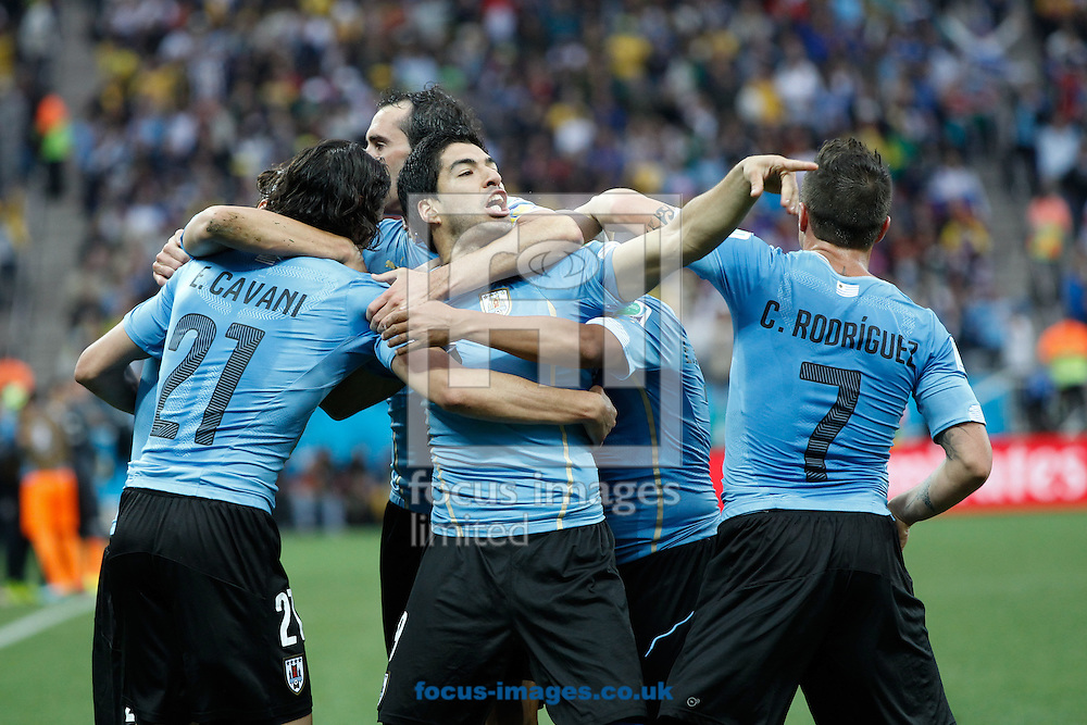 Luis Suarez of Uruguay taunts England fans after scoring his first goal during the 2014 FIFA World Cup match at Arena Corinthians, Sao Paulo<br /> Picture by Andrew Tobin/Focus Images Ltd +44 7710 761829<br /> 19/06/2014