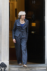 Downing Street, London, September 22nd 2016. British Prime Minister Theresa May emerges from Number Ten to welcome President of the European Parliament Martin Schulz to her official residence at Downing Street.