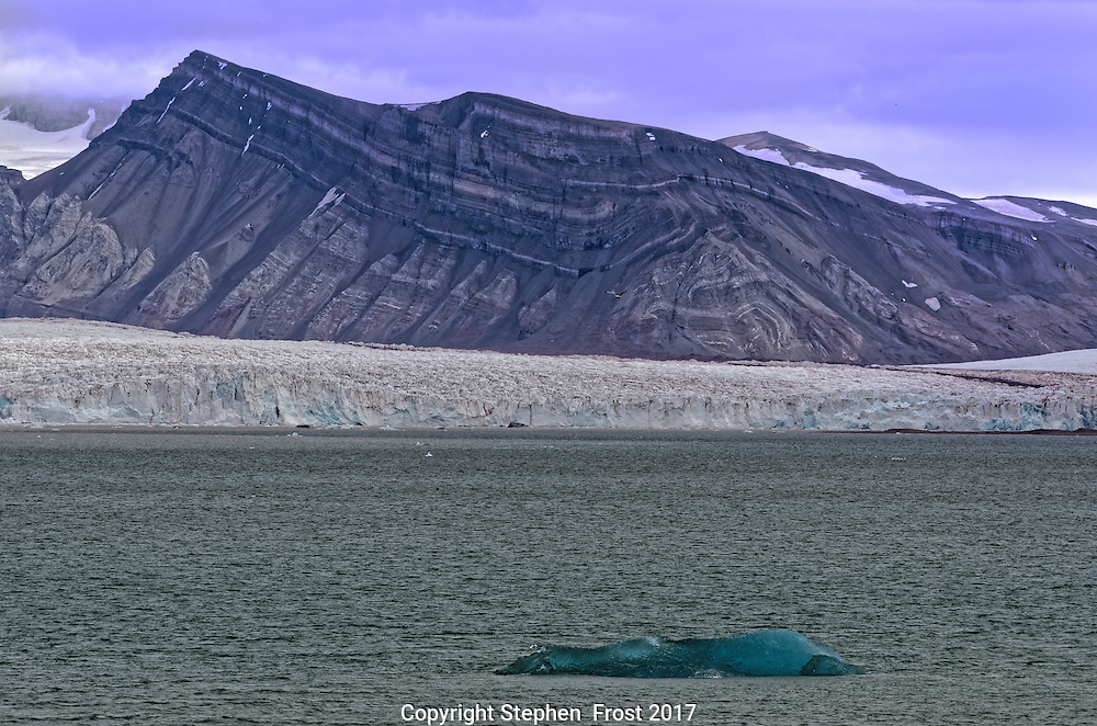 Glacier in Svalbard, with small floating iceberg.<br /> <br /> Svalbard, formerly known as Spitsbergen, is a Norwegian Archipelago in the Arctic Ocean.
