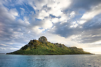 Wicked sky over the lonely  green island of Raivavae, in the Austral group of French Polynesia.  Some people rate this island the most beautiful in all the Pacific, even above Bora Bora