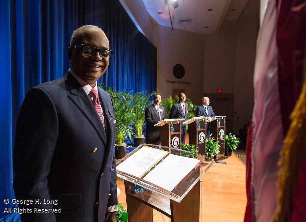 News anchor Norman Robinson with mayoral candidates, Michael Bagneris, Danatus King, and Mitch Landrieu