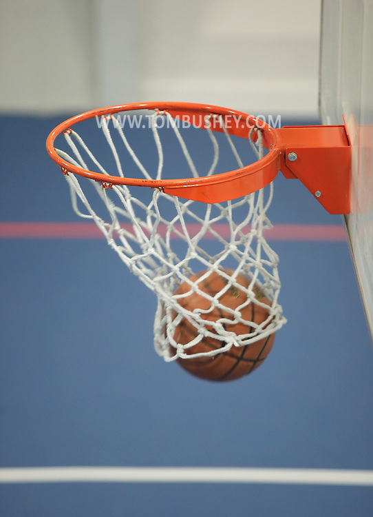 Monroe, New York - A basketball goes through the hoop at the new South Orange Family YMCA on Wednesday, Feb. 16, 2011.
