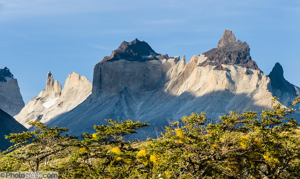 Hike under Los Cuernos (the Horns) in Torres del Paine National Park, Chile. The foot of South America is known as Patagonia, a name derived from coastal giants, Patagão or Patagoni, who were reported by Magellan's 1520s voyage circumnavigating the world and were actually Tehuelche native people who averaged 25 cm (or 10 inches) taller than the Spaniards. Panorama stitched from 2 overlapping images.