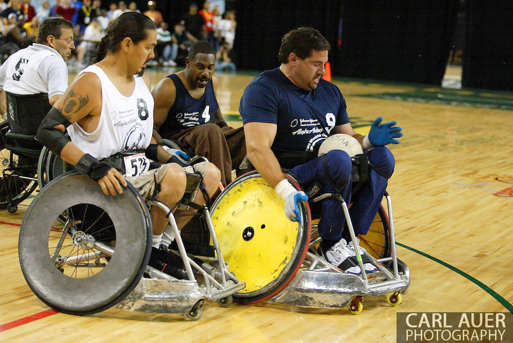 July 7th, 2006: Anchorage, AK - Blue team power scorer, Scot Severn (9) is cut off by Arron Powless (8) as White went on to defeat Blue in the gold medal game of Quad Rugby at the 26th National Veterans Wheelchair Games.