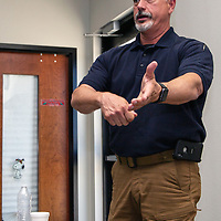 Det. Sgt. Eric K. Threlkeld of the Eddy County Sheriff's Office talks with officers on the correct way to help victims of strangulation while on scene at the Training Institutes Strangulation Prevention seminar at the Univeristy of New Mexico- Gallup campus Friday morning, May 18, 2018.